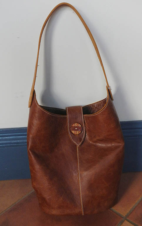 Shoulder bag with antique button $150